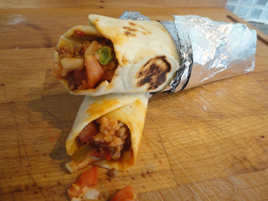 This Mexican beef and bean burrito is a cheap, easy to make recipe that is perfect for a Saturday night with the family. Delicious!