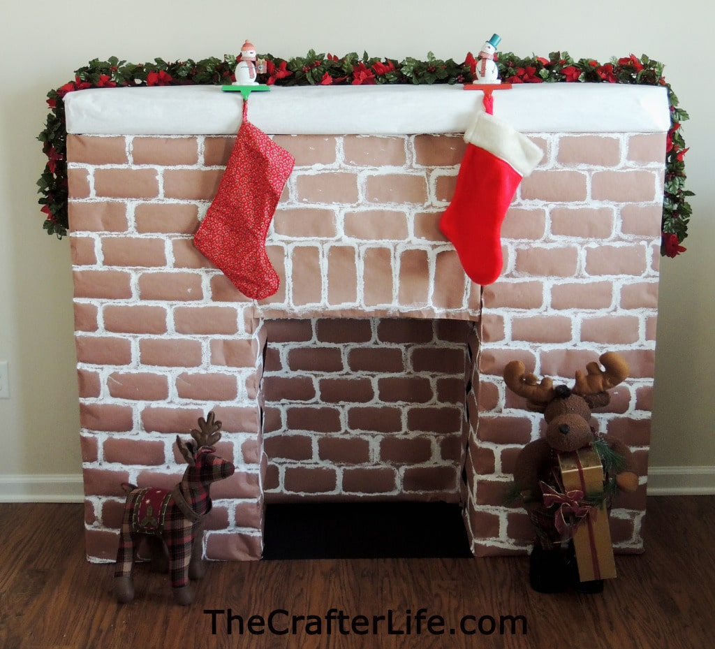 Don't miss out hanging your Christmas stocking - make a cardboard fireplace instead.