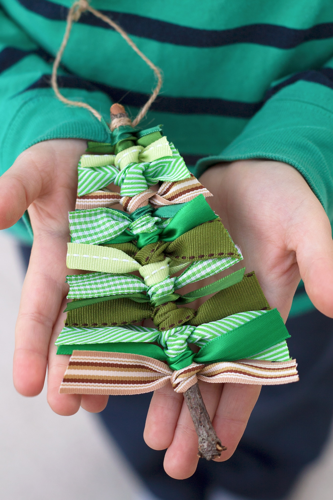 Go out to the park and burn off some energy. While you're there collect some twigs, then tie up some scrap ribbon, to make some cute Christmas tree decorations.