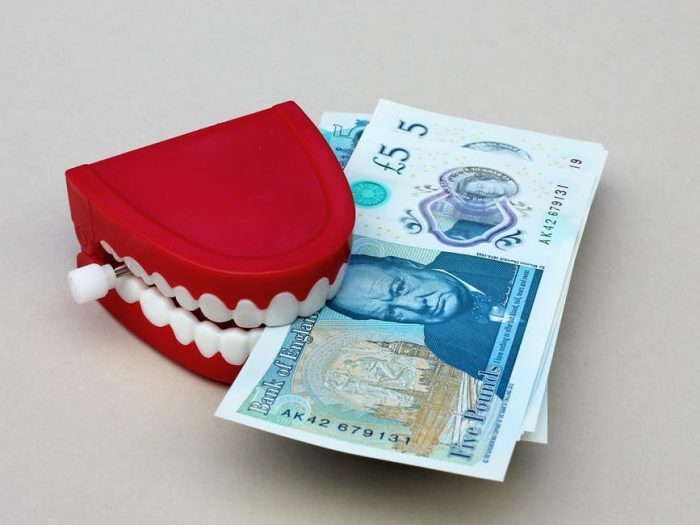 money and teeth