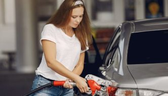 woman filling her fuel tank with petrol