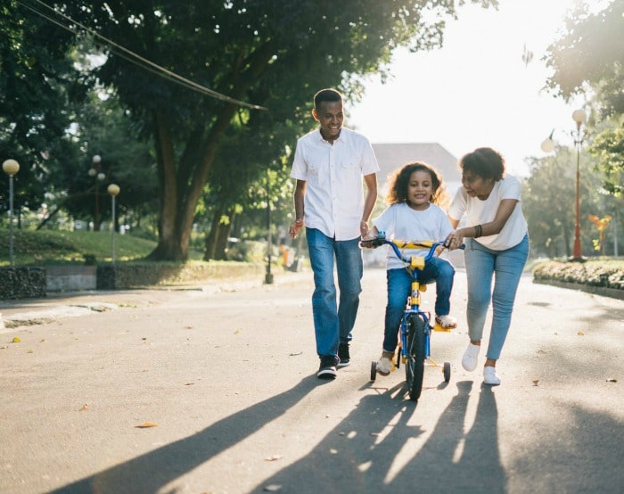 family riding bike