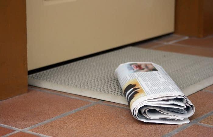 newspaper on a doormat
