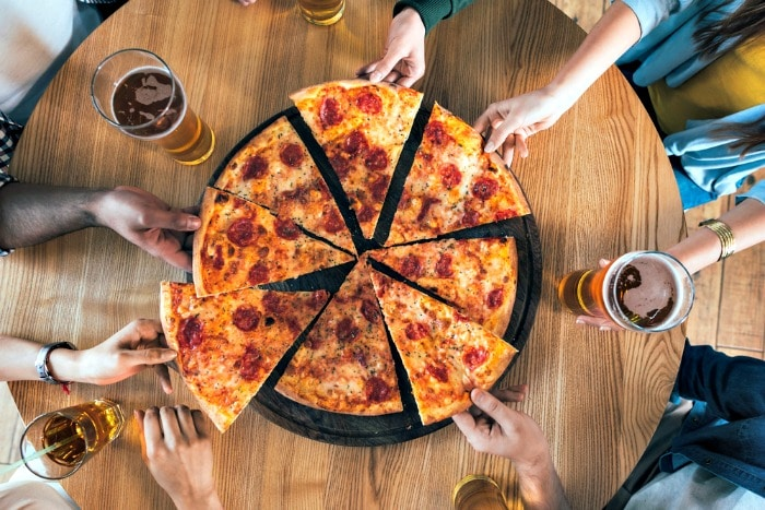 Brand new deal: Co-op has launched a new £5 Super Saver meal deal - which saves you over 50% on the price of pizza and beer!