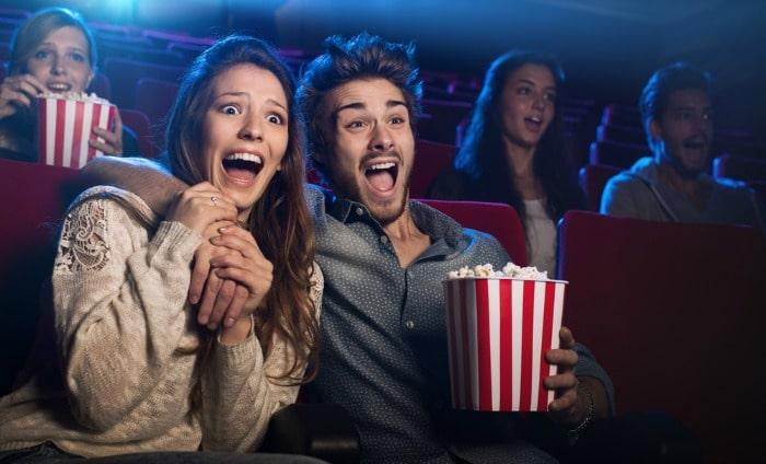 eating popcorn at cinema