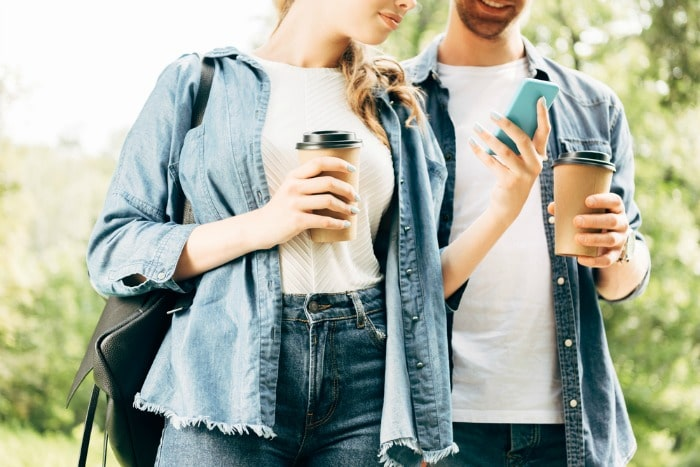 couple drinking coffee with phone