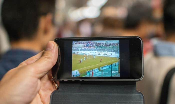 Watching a football match on mobile phone
