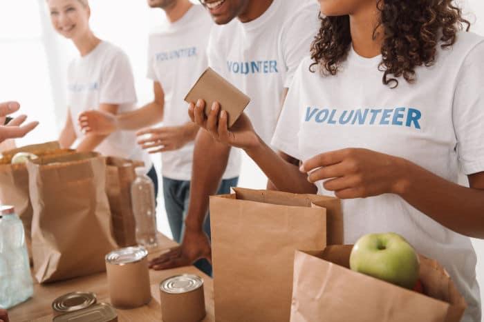 volunteers packing food donations