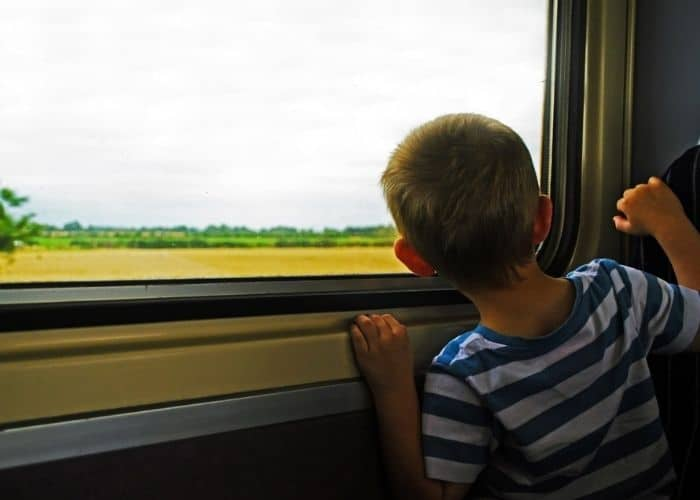 young boy travelling by train