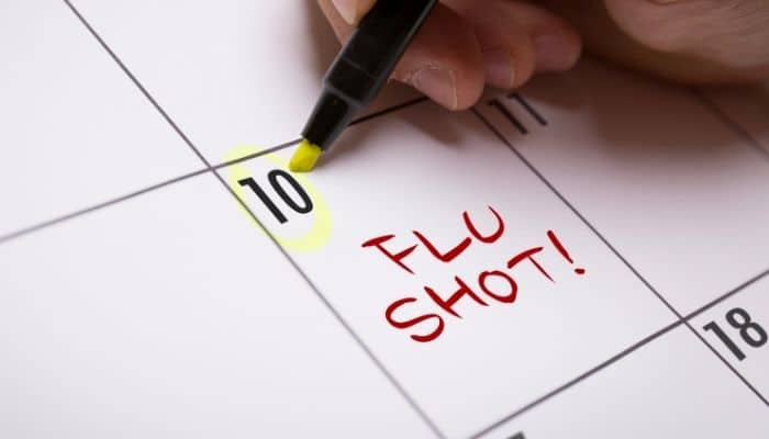 Flu vaccination written on calendar