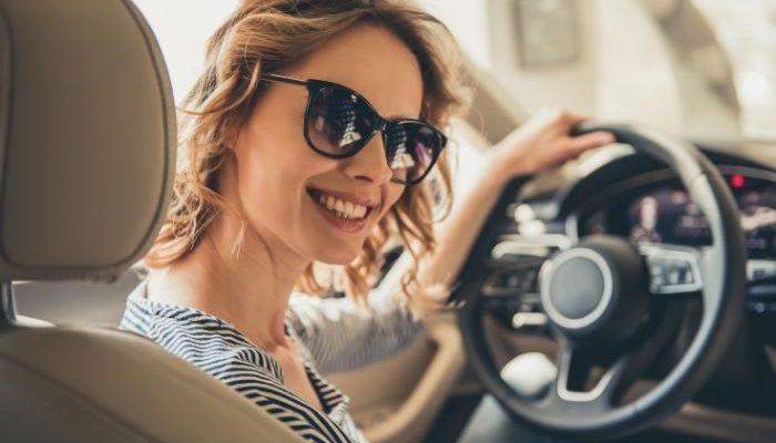 woman smiling in car