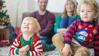 young family watching TV at Christmas