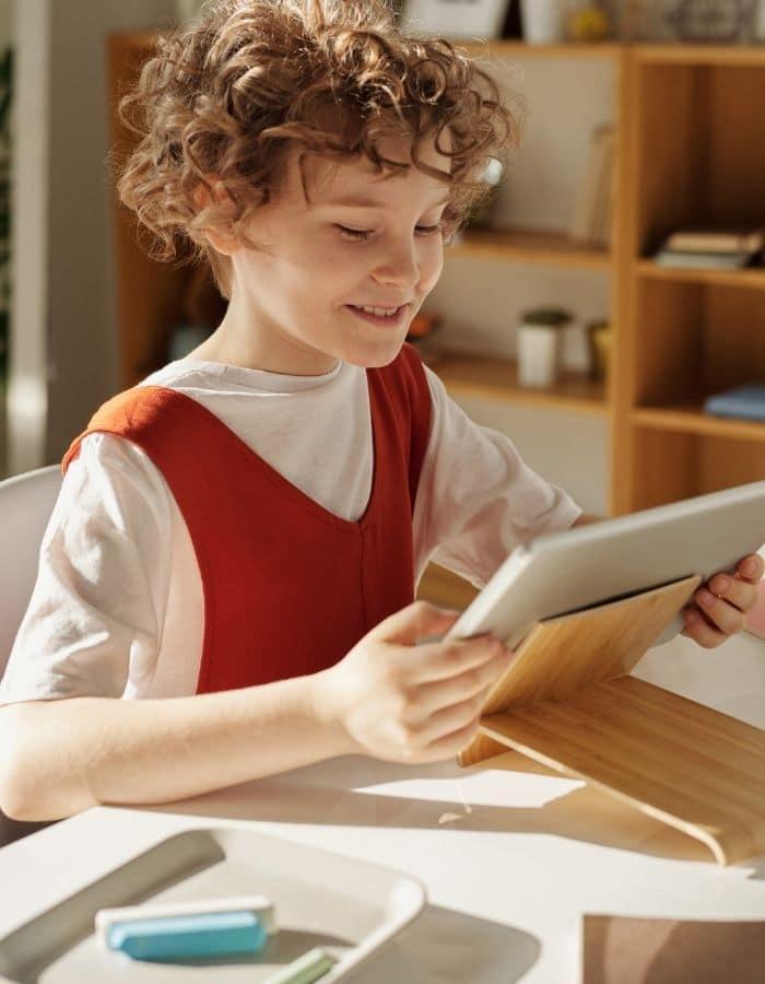 child reading from iPad