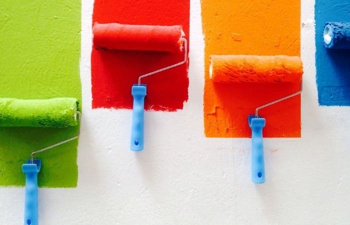 colourful paints on white wall