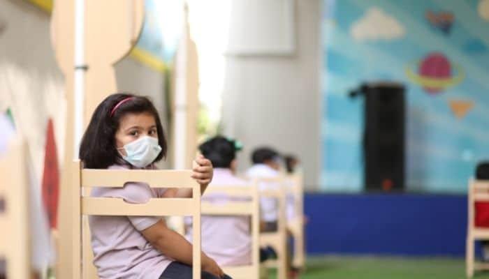 child wearing mask in school