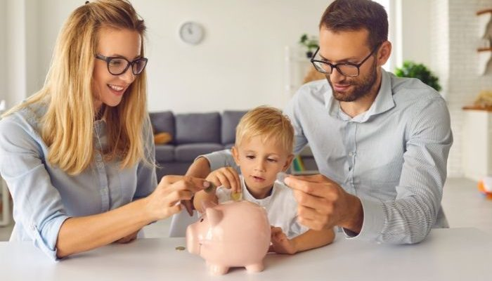 young family saving with piggy bank