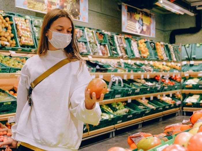 woman wearing a face mask in supermarket