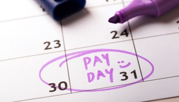 pay day written on calendar with date circled