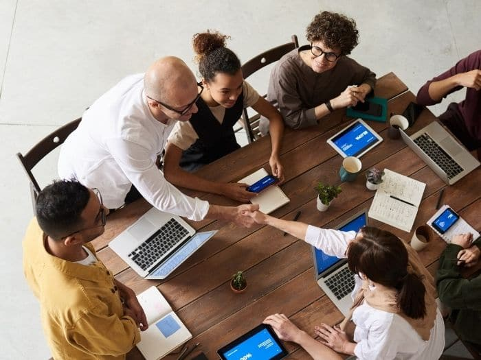 team at work shaking hands over a table