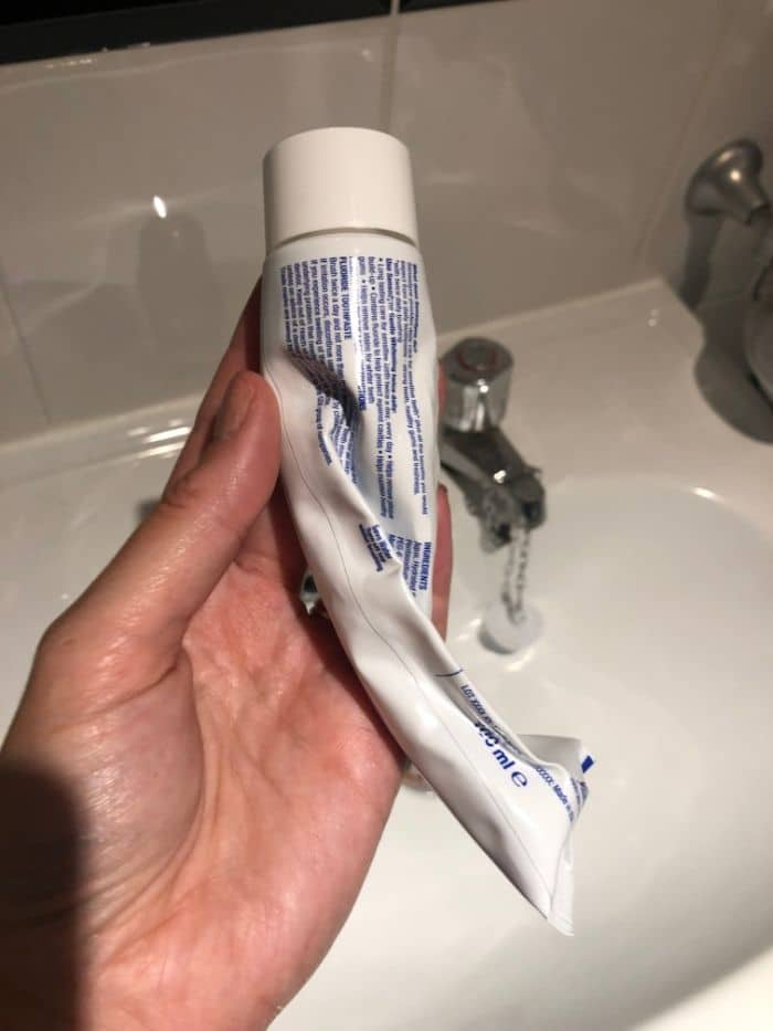 squeezed toothpaste tube
