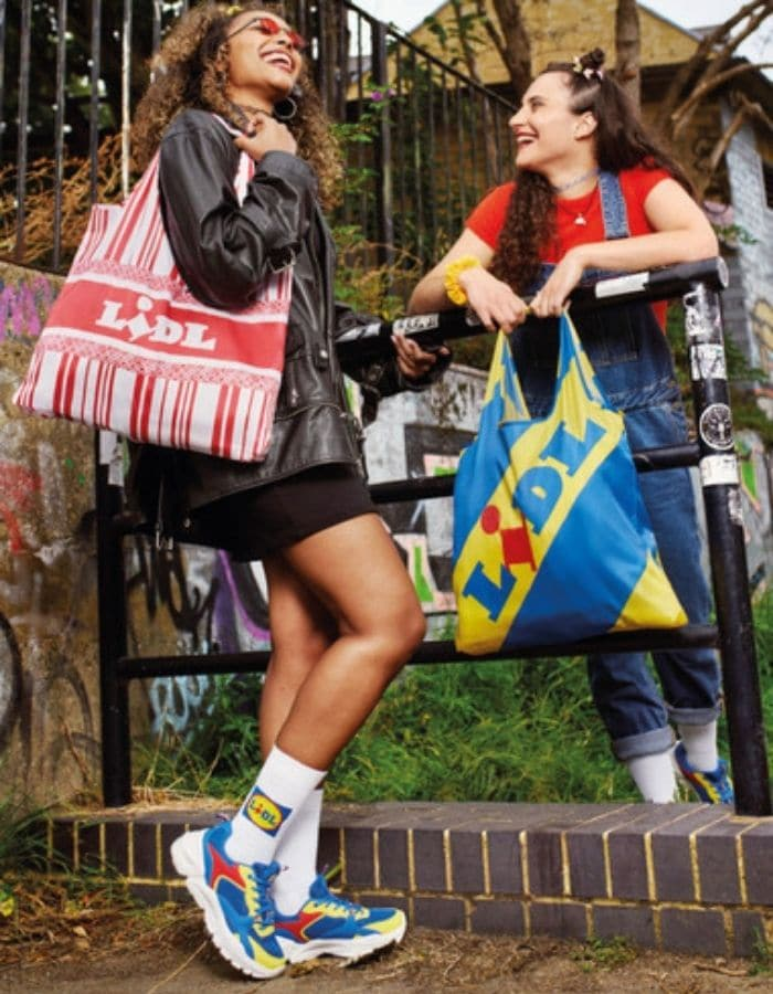 women holding lidl by lidl bags