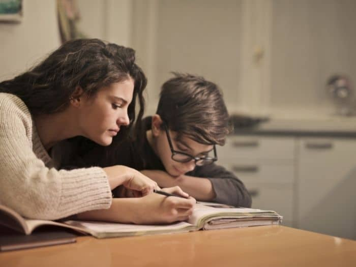 woman doing homework with a child