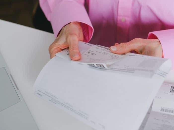 Woman holding bills