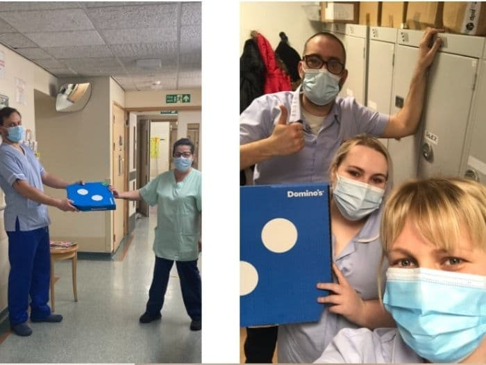 nhs staff holding boxes of pizza