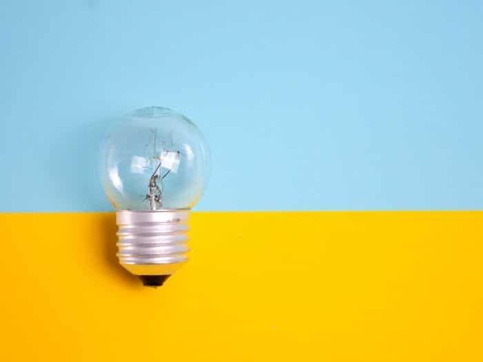 lightbulb on colourful background