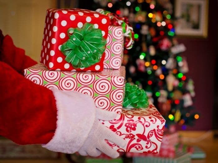 Santa Claus holds gifts